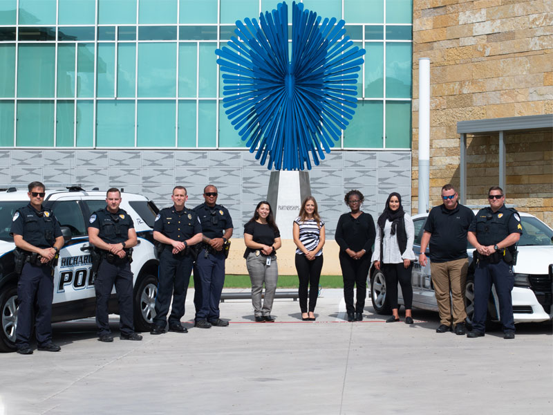 Methodist Richardson Medical Center staff and police photographed together to celebrate the creation of a joint crisis team for mental health