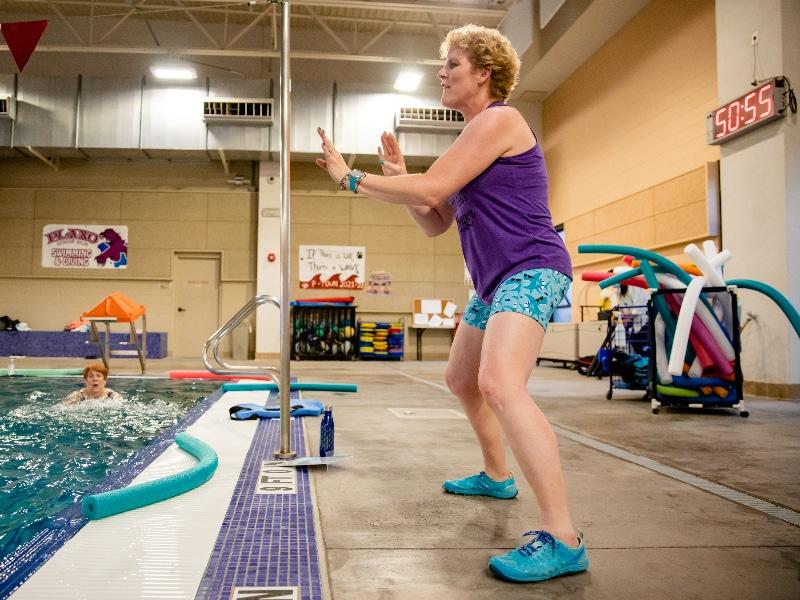 Erika Burkhardt photographed teaching a fitness class after breast cancer