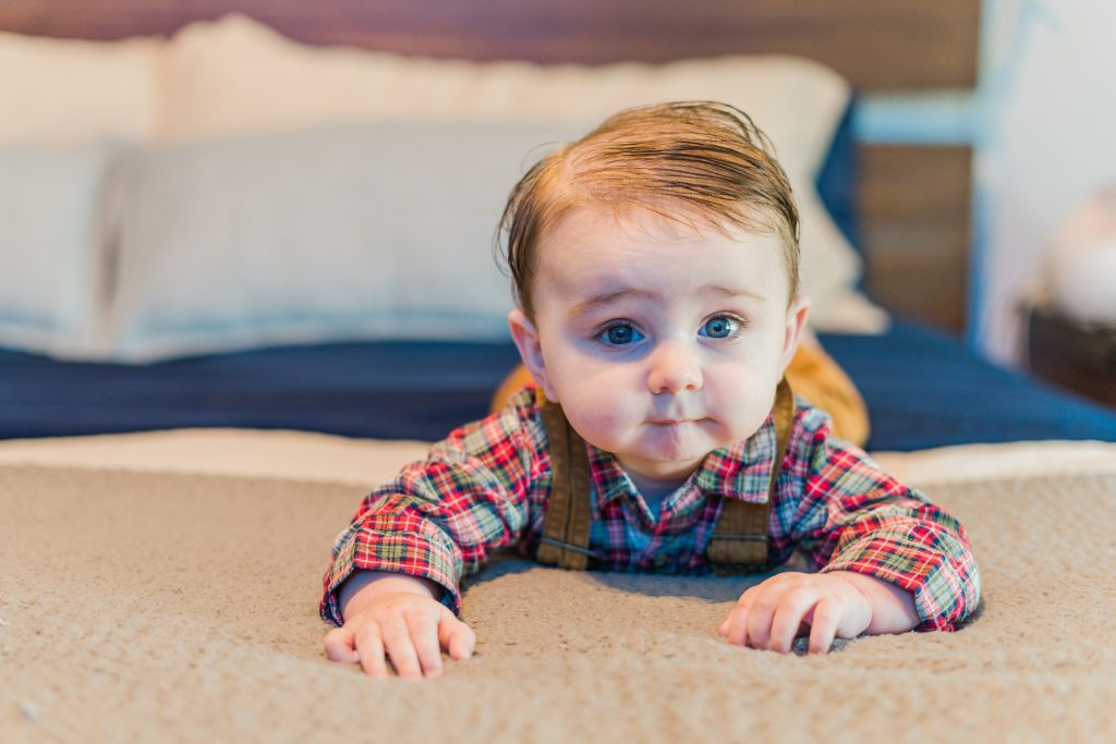 John Smith, a baby born at the Methodist Midlothian labor and delivery department, crawling on a bed