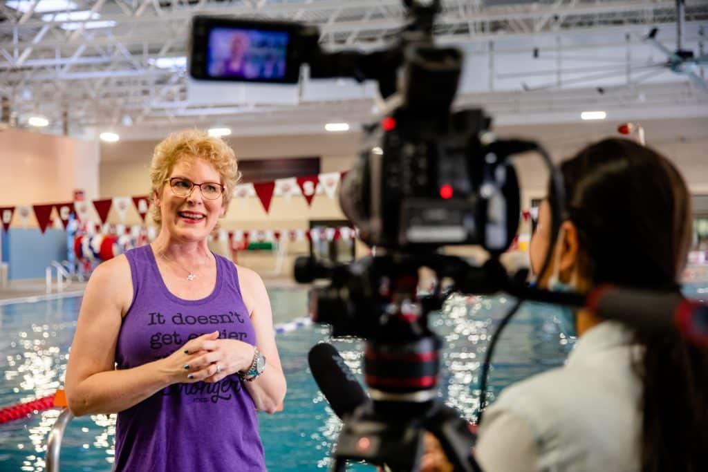 Erika Burkhardt being interviewed after surviving breast cancer