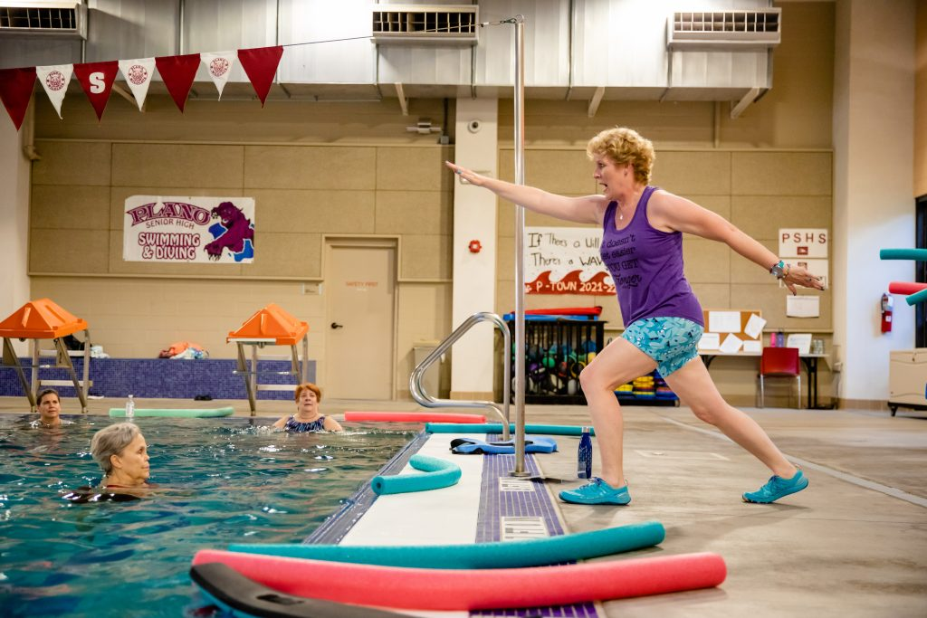 Erika Burkhardt photographed teaching a water fitness class after breast cancer