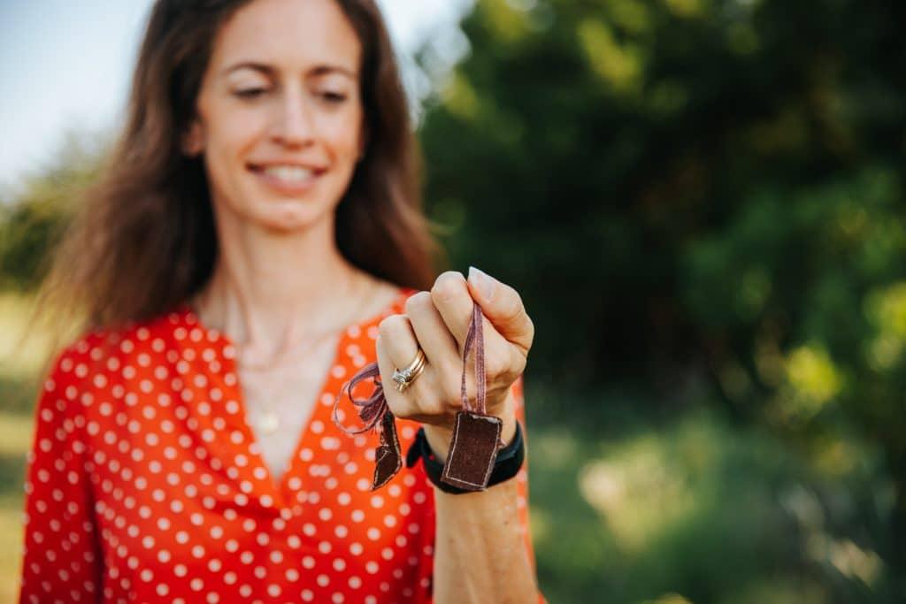 Melanie Proffitt holding a family talisman