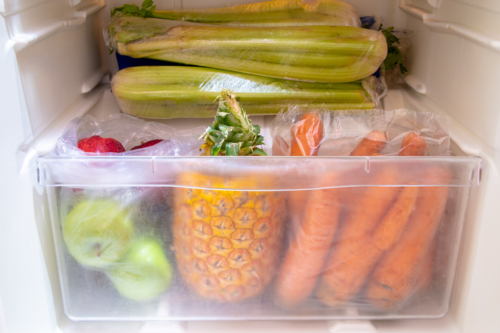 Produce in the produce drawer, such as carrots and apples and pineapples