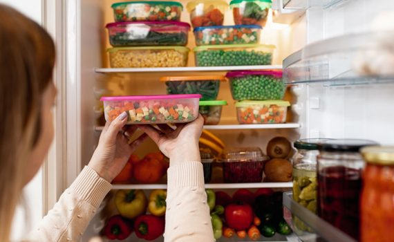 Produce and meals prepped into tupperwares in the refrigerator