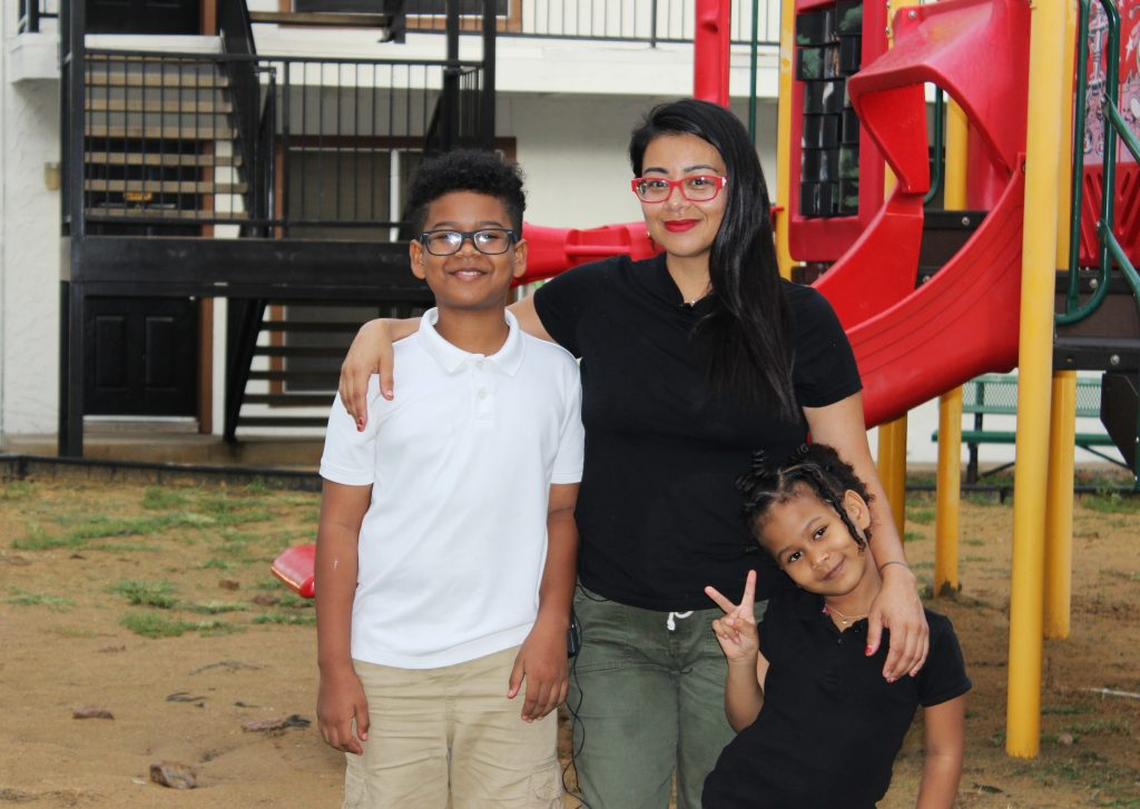 Leslie Armijo Cannon with her son and daughter