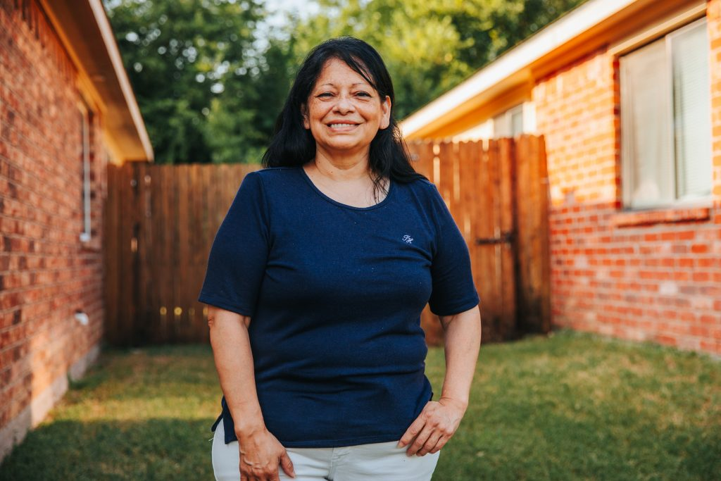 Alice Chapa photographed in a backyard