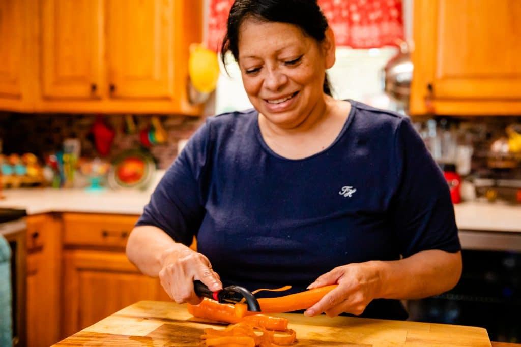 Alice Chapa slicing carrots