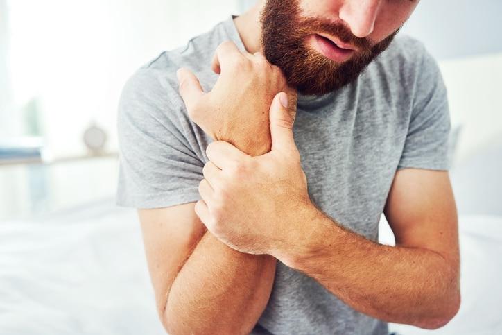 Man grabbing his wrist in pain