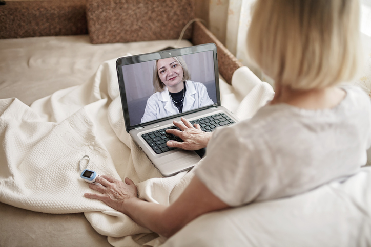 A photo of a patient visiting a physician via virtual care